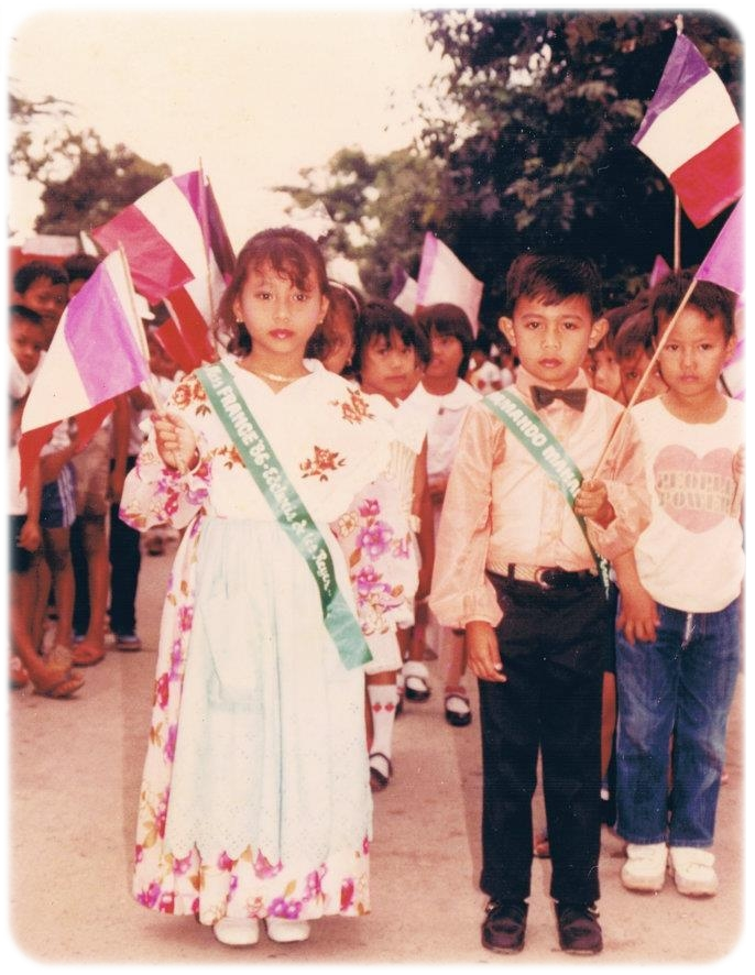 Fond memories from 3rd grade! I was the class muse then and this was taken during a parade. I believe the event was world's day or something like that. I was Ms. France and my Grandma created my costume. The floral dress was my mother's old dress then she added a white scalloped embroidered shawl and a mint green eyelet apron. The color of the flag seems off though as the purple is supposed to be blue or maybe it looks faded because the photo is quite old. Hehehehe!