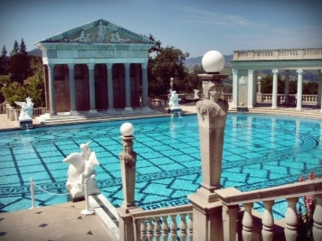 "The present version of the pool was under construction from 1934-1936. It is unlikely that the enlargement was done to make it closer to Olympic size, as has sometimes been conjectured; Olympic pools are 165 feet long. It is more likely that the colonnades and Cassou statues, which were planned from the late 1920′s, required an enlarged treatment. Morgan anticipated further modifications of the pool for Cassou's Neptune statuary group to be placed in the small upper pool. On July 27, 1936, Morgan wrote in a letter to Charles Cassou, ""enclosed is a plan and some photographs of the 'Neptune Pool' in its present (uncompleted) state. The recess of the main pool and the small pool above to receive your 'Neptune' group I have not touched since my visit with you last year – so please do not think of them except as something yet to be done to form a proper background and sitting for your 'Venus' as well as your 'Neptune' statuary."" The ""Neptune"" sculpture group by Cassou intended for the small upper pool was never installed. (hearstcastle.org)"
