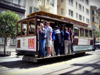 The San Francisco cable car system is the world's last manually-operated cable car system. An icon of San Francisco, California, the cable car system forms part of the intermodal urban transport network operated by the San Francisco Municipal Railway. Of the twenty-three lines established between 1873 and 1890,[4] three remain (one of which combines parts of two earlier lines): two routes from downtown near Union Square to Fisherman's Wharf, and a third route along California Street. While the cable cars are used to a certain extent by commuters, the vast majority of their 7 million annual passengers are tourists.[5] They are among the most significant tourist attractions in the city, along with Alcatraz Island, the Golden Gate Bridge, and Fisherman's Wharf. The cable cars are listed on the National Register of Historic Places.[1] The cable cars are not to be confused with San Francisco's heritage streetcars, which operate on Market Street and the Embarcadero. (Wikipedia)